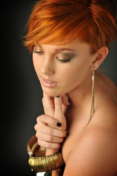 I love this copper hair pixie cut. Very soft yet funky colour