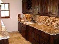 Backsplash in kitchen with granite countertop