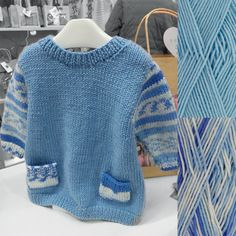 Easy Knit Baby Tunic Knitting Kit in blue with Faux Fair Isle look sleeves and pockets.