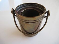 Brass Match Holder/striker in the form of a bucket. 5cm high. In excellent condition.