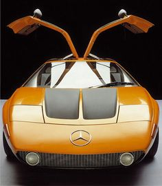 Mercedes-Benz C111-II experimental car (1970) with mid-mounted four-rotor direct fuel injected pistonless Wankel engine, multi-link rear suspension, fibreglass body shell and gullwing doors, attained a top speed of 300 km/h