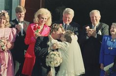 Ted Kennedy Jr., kisses his new bride Katherine Gershman as his father U.S. Senator Edward Kennedy and Joan B. Kennedy, watch them depart Sunday, Oct. 10, 1993 outside St. Andrew's Church in New Shoreham, R.I., on Block Island.