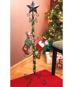 Standing Holiday Stocking Holders. This is a cute idea since we don't have a fireplace