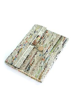 """This unique journal features a recycled woven newspaper cover which is durable yet soft to the touch! The purchase of this ethically handmade stationery employs fair trade artisans working in Bangladesh with Prokritee, which means """"nature"""" in Bengali. Please note that due to the handmade nature of fair trade items, slight variations are to be expected and add to the charm and authenticity.    Approx. 8.5"""" L x 6"""" W   Recycled Newspaper Journal by Fair & Square Imports. Home & Gifts - Gifts…"""