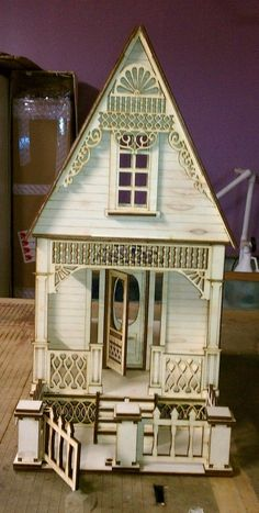 nice details on this Little Ann Victorian Cottage 1:12 scale dollhouse kit. This would make a very cute painted cottage - and it's small enough that the intricate painting needed to highlight the gingerbread trim wouldn't take forever.