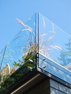 """glass railing design, The gap between the glass panels is approximately 1.5"""" which is substantially less than the code requirement, which is 4"""" for openings in railings or guardrails. They allow 100% visual clarity, so if you have"""" """"a view from your deck there is nothing obstructing your view. The only cons can be keeping it clean and the cost is on the higher end of the spectrum of railing material"""