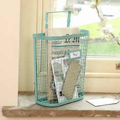 This distressed wall storage is crafted using metal and finished in turquoise spearmint blue with a slight distressed edge this hanging wall storage rack is fantastic solution for spaces where floor space may be limited. Complete with a label slot to the front. Purchase yours at www.dibor.co.uk