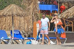 Pin for Later: Take a Virtual Vacation With the Most Stylish Beach-Bound Celebs Kate Hudson Kate Hudson hit the beach with Matt Bellamy and added interest to her white top with colorful tie-dyed shorts and a Summer-perfect fedora.