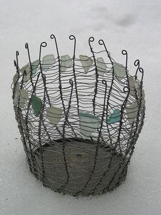 Sticking with the nautical theme, a sea glass wire basket looks pretty and adds casual storage