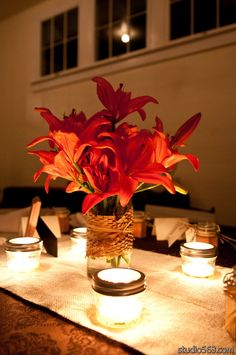 Orange lilies are the perfect shade for this rustic fall wedding here in Austin, TX at Star Hill Ranch