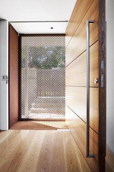Laser-cut Corten steel screen door by [MCK Architecture & Interiors]