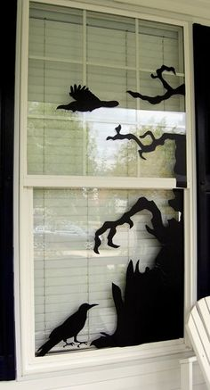 I do this with black construction paper and an exacto knife. Tape paper together for big things like a witch, coffin, mummy, tree etc. Sooo many possibilities!