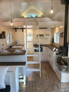 The large kitchen offers a huge amount of counter space compared to most tiny homes, plus it has an extra bench seat for two people.