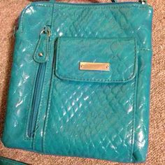 Turquoise cross body purse This has so many compartments for so many things! Lots of space, perfect size, a place for your phone in the front, spaces for your cards, your ID, and your money right in the middle where it's easy to get to. Four zippers (not including the once inside the middle one). Beautiful color! Nice condition! Bags Crossbody Bags