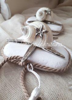 Πρωτότυπες μπομπονιέρες γάμου μεταλλικός Αστερίας με κοχύλι φιλντισι πανω σε βότσαλο by valentina-christina handmade products καλέστε 2105157506
