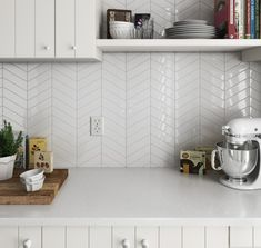 These new Chevron wall tiles would make a stunning splashback or feature wall, use contrasting grout to make the space pop or matching grout for a subdued but more interesting feel than plain subway Kitchen Wall Tiles, Ceramic Wall Tiles, Kitchen Flooring, Bathroom Wall, White Kitchen Backsplash, Bath Tiles, Kitchen Black, Tuile Chevron, Chevron Tile