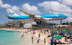 *Not Photoshopped* - Boeing 747 Landing at St. Maarten island in the Caribbean (one of the 10 most dangerous airports in the world).  At the end of the runway is wire fencing that brave (nutty) visitors can cling to in order to experience the jet thrust of Boeing 747 engines.