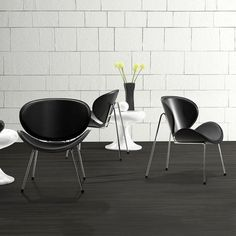 2 Pc Set Lounge Chairs - Black | What guest wouldn't stay awhile when offered a seat on this Modern Lounge Chair? The organic shape of the back rest and seat offers comfort while the chrome steel legs and rubberized feet ensure a sturdy position. Push it up against a home office desk or pair it with another midcentury armchair for a polished modern look.
