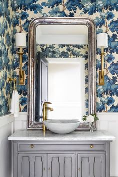 23 Whimsical Powder Rooms - Powder Room Design Ideas Embrace playful textures, patterns, and colors. Coastal Powder Room, Blue Powder Rooms, Modern Powder Rooms, Powder Room Mirrors, Bathroom Mirrors, Small Bathroom, Blue Floral Wallpaper, Cage Pendant Light, Powder Room Design