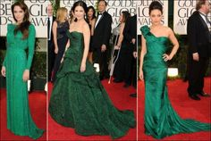 2011 Golden Globe red carpet dresses. EMERALD Angelina Jolie looks poised in a long sleeved Atelier Versace dress. Catherine Zeta Jones wears a strapless Monique Lhuillier gown. Mila Kunis models a one-shoulder Vera Wang gown.