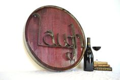 Hey, I found this really awesome Etsy listing at http://www.etsy.com/listing/98294169/laugh-authentic-wine-barrel-head-sign