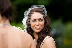 beautiful bride with birdcage veil