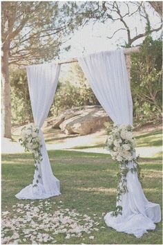 Has anyone made a wedding arch like this? What fabric do you suggest and how to replicate the flowers using fake. : weddingplanning