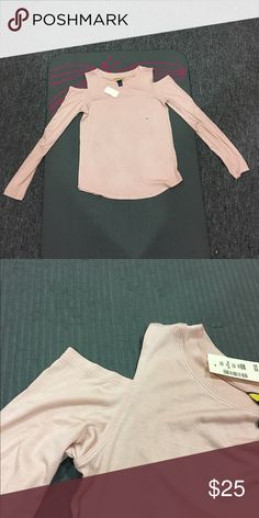Long sleeve cold shoulder top Light pink cold shoulder top with long sleeves. Slightly loose fitting. Super cute and comfy. Brand new with tags. Feel free to make me a reasonable offer Aeropostale Tops