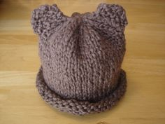 Baby Bear Hat -- good basic pattern for roll bottom stockinette hat.  We used preemie sizing and it needs to be shorter -- perhaps 5.5 inches.  Super Easy beginner project, Holly did it in a few hours.