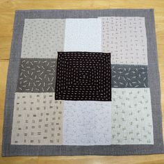 slow stitched linen table mat