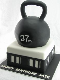 Kettlebell Cake: All chocolate mudcake with milk chocolate ganache filling and covered in black and white fondant.