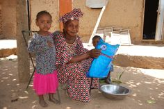 A mother and her children with a brand new mosquito net. http://plan-international.org/where-we-work/africa/mali/about-plan/news/in-pictures-tackling-malaria-in-mali