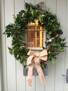 My home made diy Christmas wreath with foraged holly, berried ivy, grey and silver mini glass baubles and hessian ribbon. Simple, but a classic combination.