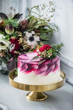 This stunning wedding cake flaunts a painted watercolor technique to incorporate swashes of the bride's colors into the icing. It's almost too beautiful to eat, don't you think?