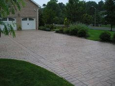 I like the look of the stamped concrete driveway. I may not want this exact design but it at least gives you an idea.
