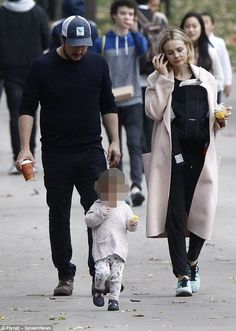 Relaxed: The actress, 32, sported a pink coat as she joined her husband and their two-year...