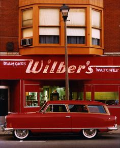 Wilber's Diamonds & Watches, neon sign on red & white background, william eggleston