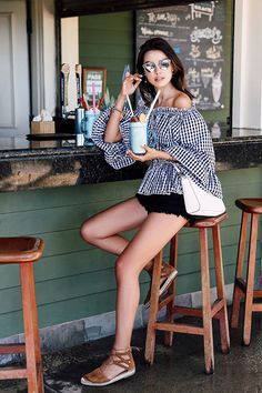 summer outfit, casual outfit, night out outfit, beach outfit, summer getaway outfit, summer vacation outfit, summer travel outfit- silver mirror sunglasses, black check print off the shoulder top, black denim shorts, brown lace up espadrilles, white shoulder bag