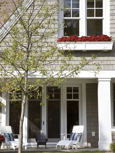 gorgeous doors, love the windows & window box, the gray shingles, white accents