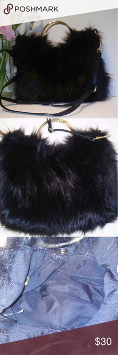 "NWOT faux fur crossbody/boho bag This faux fur is so soft, I thought it was rabbit fur for a second. It is a gloriously cute purse. Wear it as crossbody boho style with jeans or remove the strap and carry it as a purse with a fabulous little black dress. It can be dressed up or down and I love it! I would keep it, but my husband would roll his eyes back so far into his head they would get stuck, and I can't afford his eye surgery!  31"" strap drop (adjustable), 14"" x 11"". Magnetic closure…"