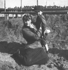 Anastasia with Peasant Boy Whose Father Was Heroically Killed in Battle, Mogilev, 1916