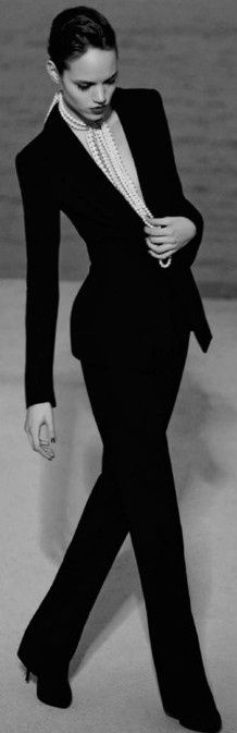 Classsic clean cut black fitted suit with a plunging neckline makes the pearl strands all the more decadent to add. Reminiscent of Chanel.