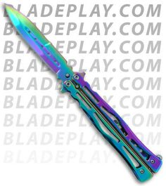Skeptic Butterfly Knife Flipper Oil Spill Spectrum Plain) if these weren't illegal here I'd get one :P Butterfly Knife, Rainbow Butterfly, Butterfly Kisses, Martial Arts Weapons, Case Knives, Throwing Knives, Knives And Swords, Lame, Folding Knives