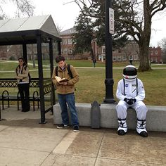 Astronaut handing out astronaut ice cream at a bus stop at UNH #wildcatcountry