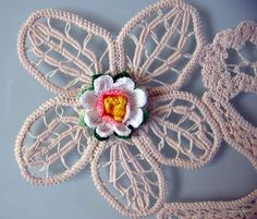 Crochet flower on Romanian Point Lace background
