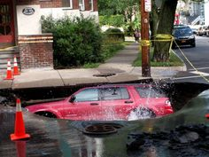 Sinkhole swallows student's SUV: Dramatic photos - SFGate