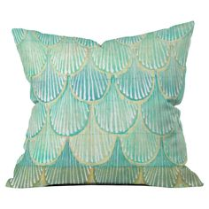 Add a pop of style to your sofa, arm chair, or window seat with this delightful pillow, showcasing a charming scallop motif.