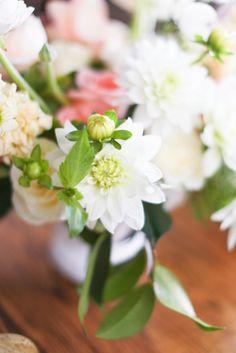 A beautiful white dahlia table arrangement by Frances Floral Design for a Colorado wedding.