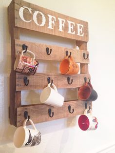 Step-by-Step Instructions: Build this DIY coffee cup holder from an old pallet. Wall hooks from any hardware store make the perfect storage for all your favorite mugs. #pallets #diy
