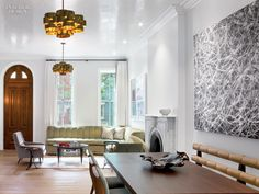 In a renovation by Markzeff, the front of the parlor floor of a West Village town house became the living and dining areas. Each is lit by a C. Jeré pendant fixture. Phot...